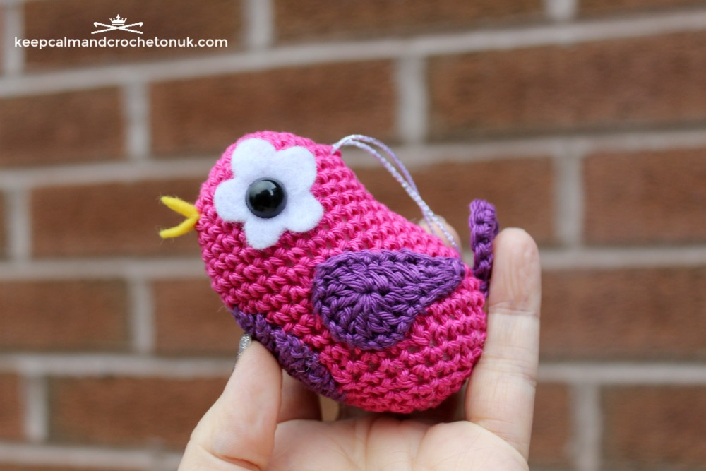 Small crocheted amigurumi bird