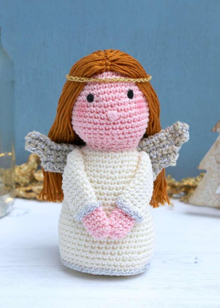 Crochet angel amigurumi against a blue background